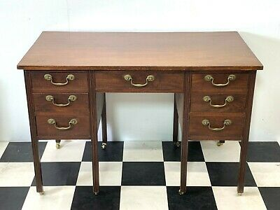 Antique Edwardian mahogany knee-hole desk seven drawers brass handles & castors