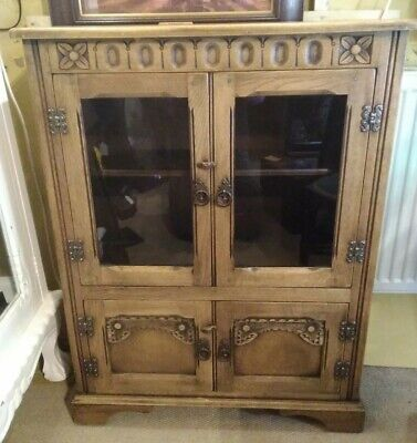 Arts and crafts antique small bookcase with cupboard, lovely looking, in oak