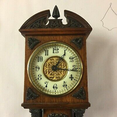 A  Edwardian  Miniture Longcase Clock