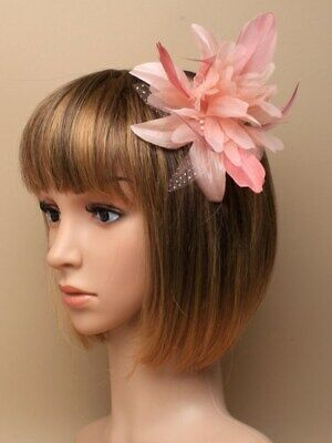 Light coral feather flower fascinator on comb.