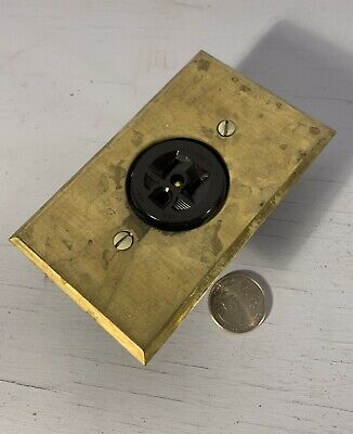 Antique Hubbell grounded outlet w/ round brass cover plate