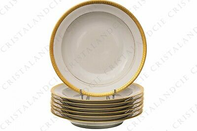 Sept assiettes creuses incrustations or par Chastanier. Seven soup plates gold