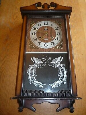 Lava 31 Day Wooden Wall Clock Wind Up Korea. No Pendulum or key Spares Repairs
