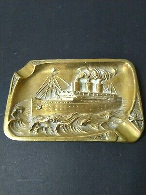 A vintage solid brass ashtray depicting the Queen Mary ship