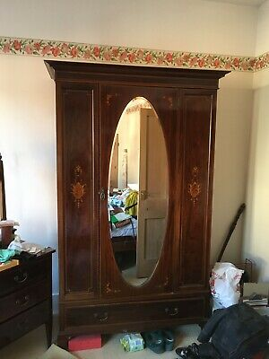 An Edwardian Lady's Wardrobe With Oval Mirror To Central Door