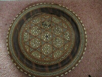 Wooden marquetry decorated round plaque