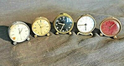 4 Vintage Oris Small Table / Travelling Clocks And A Cyma Travelling Clock