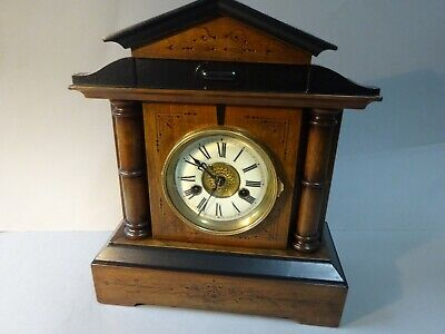 H.A.C. ebony and walnut striking table/mantle clock