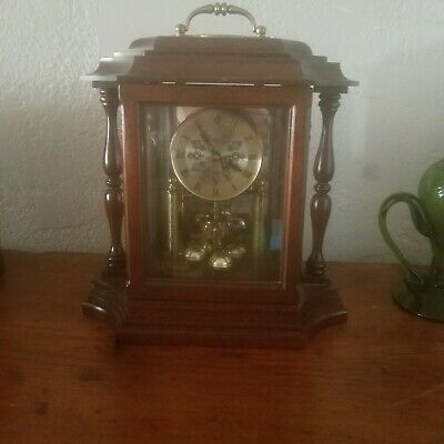 MANTLE CLOCK BY H L HUBBELL SPINDLE WOOD. WORKS: Quartz W 993 S. Haller Germany