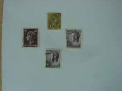 A small selection of 4 old used stamps from Luxembourg