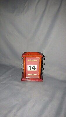 AN EARLY 20th CENTURY WOODEN PERPETUAL CALENDAR