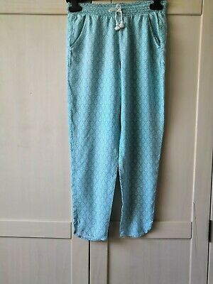 Girls green patterned loose H&M trousers elasticated waist size 9-10 years