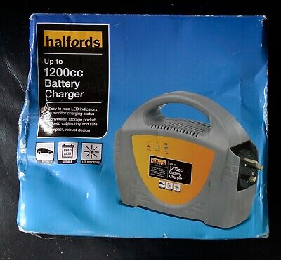 HALFORDS UP TO 1200cc BATTERY CHARGER NEVER BEEN USED.