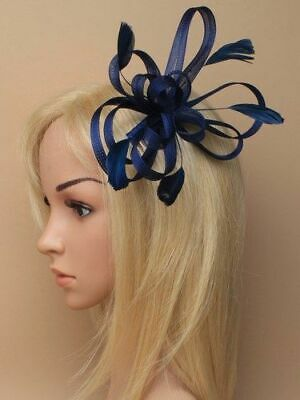 Navy blue looped fascinator with feathers on comb.