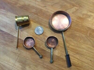 Vintage tiny Copper and brass measuring dishes.