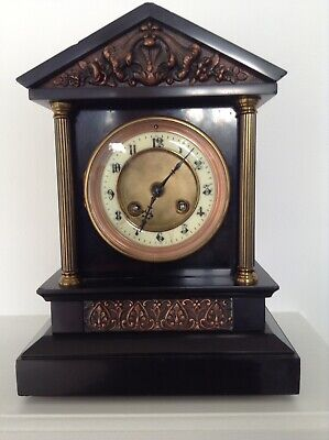 A  Black Slate  architectural style mantle clock.