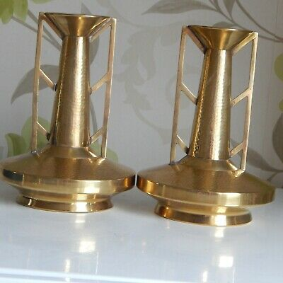 A good stylish pair of Art Deco brass vases signed with a monogram