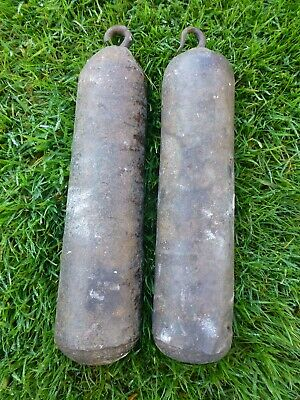 Genuine an original pair of long-case clock weights in cast iron 15lbs & 14lbs