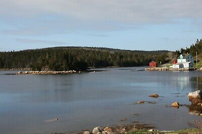 WATERFRONT PROPERTY with four season house and outbuildings. Canada, east coast.