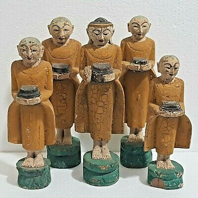 19th Burmese Myanmar Set of Wood Monks Statues Carrying an OfferingAlms Bowls.