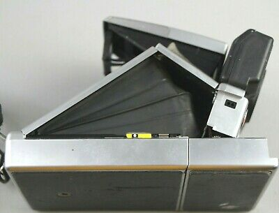Vintage Polaroid SX-70 Land Camera Sonar OneStep Instant with a film cartridge