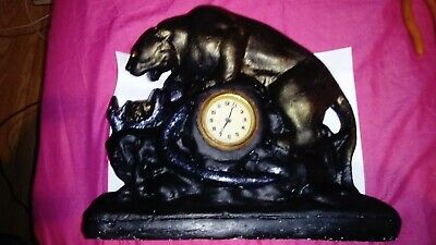 Vintage Alabaster Puma and Snake Fighting figurine with mechanical clock.
