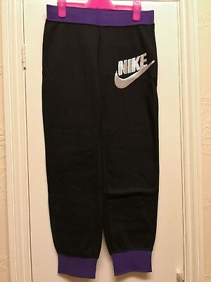 Nike Girl purple and black teacksuit bottoms size XL 13-15 years Women's size 8