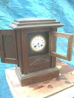 Clock Mantel  Wooden Cased   Striking On A Bell