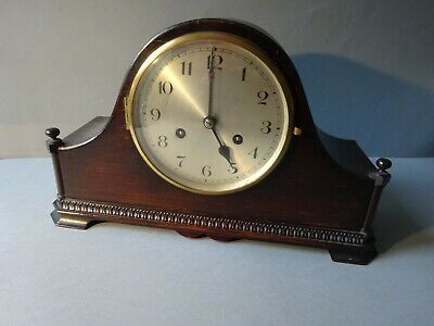 Striking dark oak cased mantle clock
