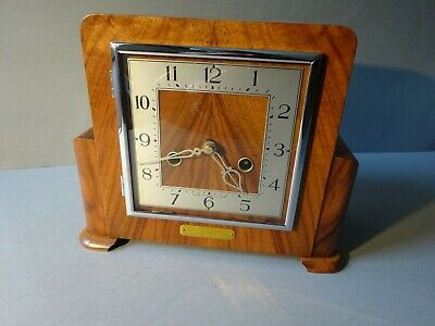 Smiths Walnut cased striking mantle clock.