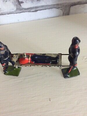 LEAD FIGURES.LATE 19th/early 20th Century STRETCHER WITH FIGURES