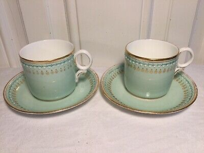 Pair of  vintage White green and gold gilded Cups and Saucers