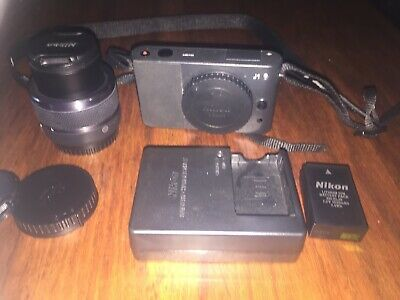 Nikon 1 J1 Mirrorless Compact Camera W/ Nikkor 10-30mm Lens,Charger,Strap