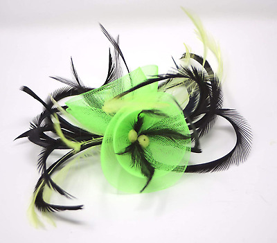 Neon lime green and black fascinator on comb