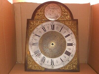 Antique grandfather clock dial, brass with spandrals.