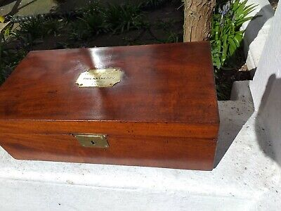 large. solid mahogany writing slope with 2 bakerlite inkwells. circa 1850. nice