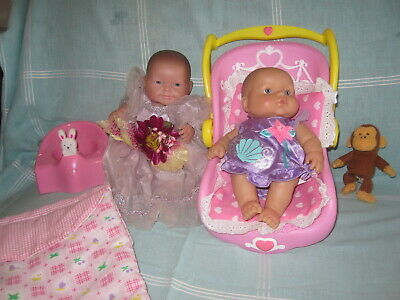 Berenguer Lots to Love dolls x 2, singing potty, sleeping bag, carrier, clothes