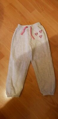 Young Dimension Primark Girls' light grey joggers with pink heart motif |age 6-7