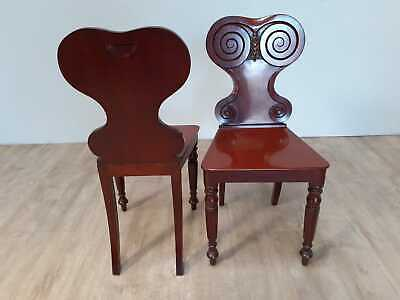 A pair of early Victorian hall chairs