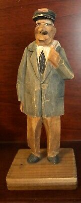 Signed Carving Hand Carved by Trygg Man smoking cigar carrying backpack postman