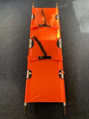 Large Orange Folding Stretcher With Straps And Foot Stands and storage bag