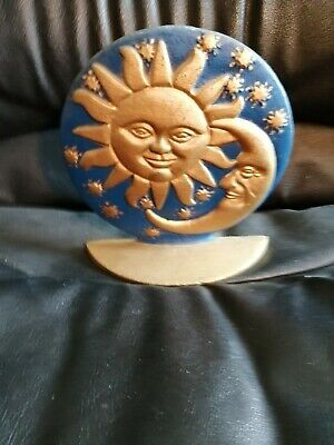 Heavy cast iron sun and moon book end