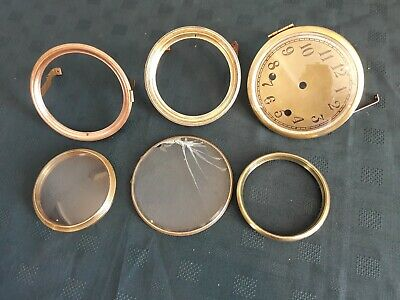 Five Antique clock bezels plus clock dial