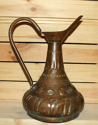 Antique Middle East hand made ornate wrought copper pitcher jug