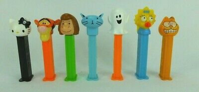 7 Pez Dispensors Inc. Tigger, Garfield, Hello Kitty, Halloween Ghost