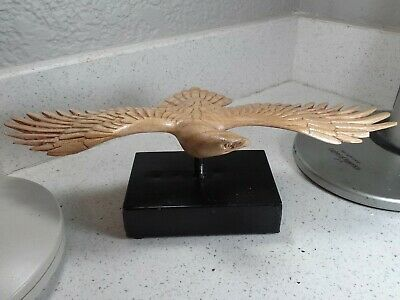 Outstanding folk art carved wood soaring bird sculpture on metal base
