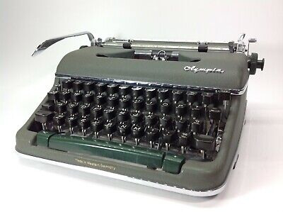 Vintage Olympia SM4 Portable Typewriter with Hard Case