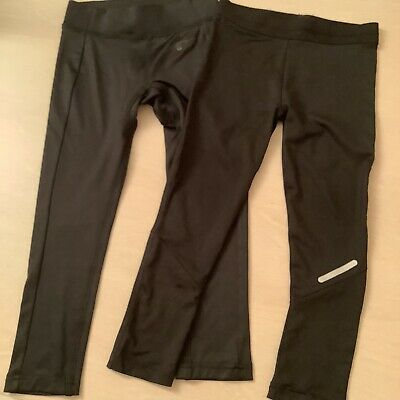 Two pairs of girls black tracksuit bottoms age 5-6 years