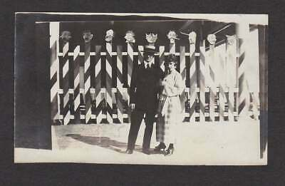 Creepy Carnival Ride Heads On Poles Fancy Couple Old/Vintage Photo Snapshot-H473