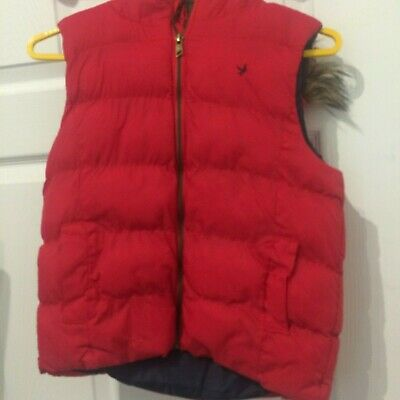girls sleevless red jacket age 12-13 years